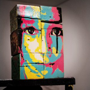 Artist Kleber Cianni stencil on sculpture