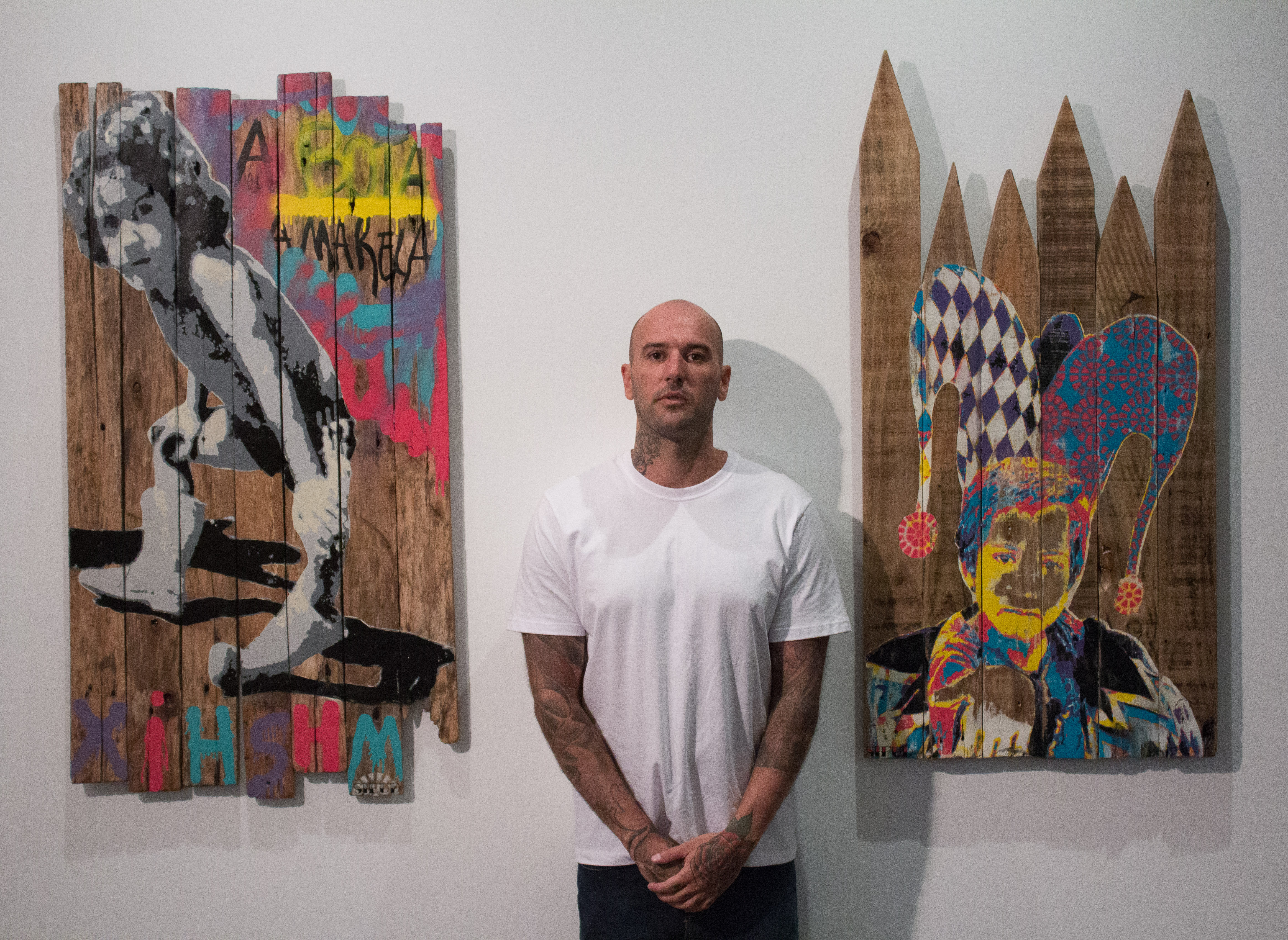 Artist Kleber Cianni standing with