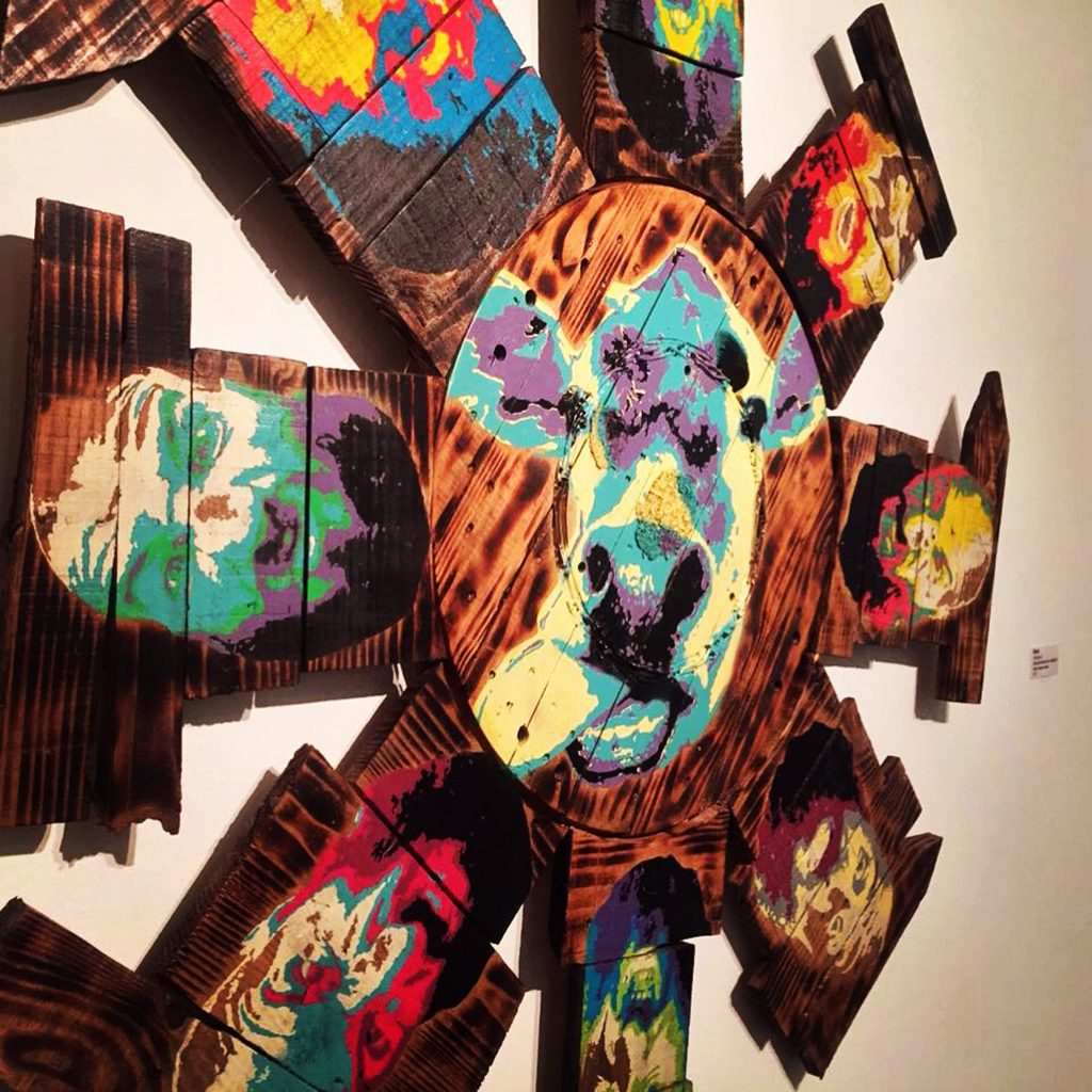 Artist Kleber Cianni stencil work on wood