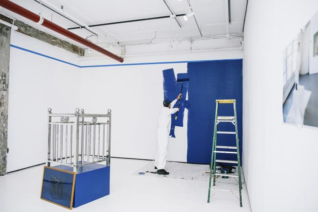 Manufracture Series: Steel and Benjamin Moore installation and live Performance/ stainless steel fence, C-Print, paint, painting tools and accessories, a wooden pedestal, a frame, and live performance dimensions variable 2016