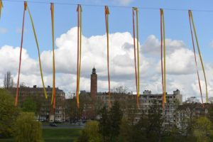 work by former resident artist at glogauair, Laurent Trezegnies, Parkunst Brussels Sculpture, colored straps, in motion, 80 meters length, 8 meters high, straps /2M, 2016