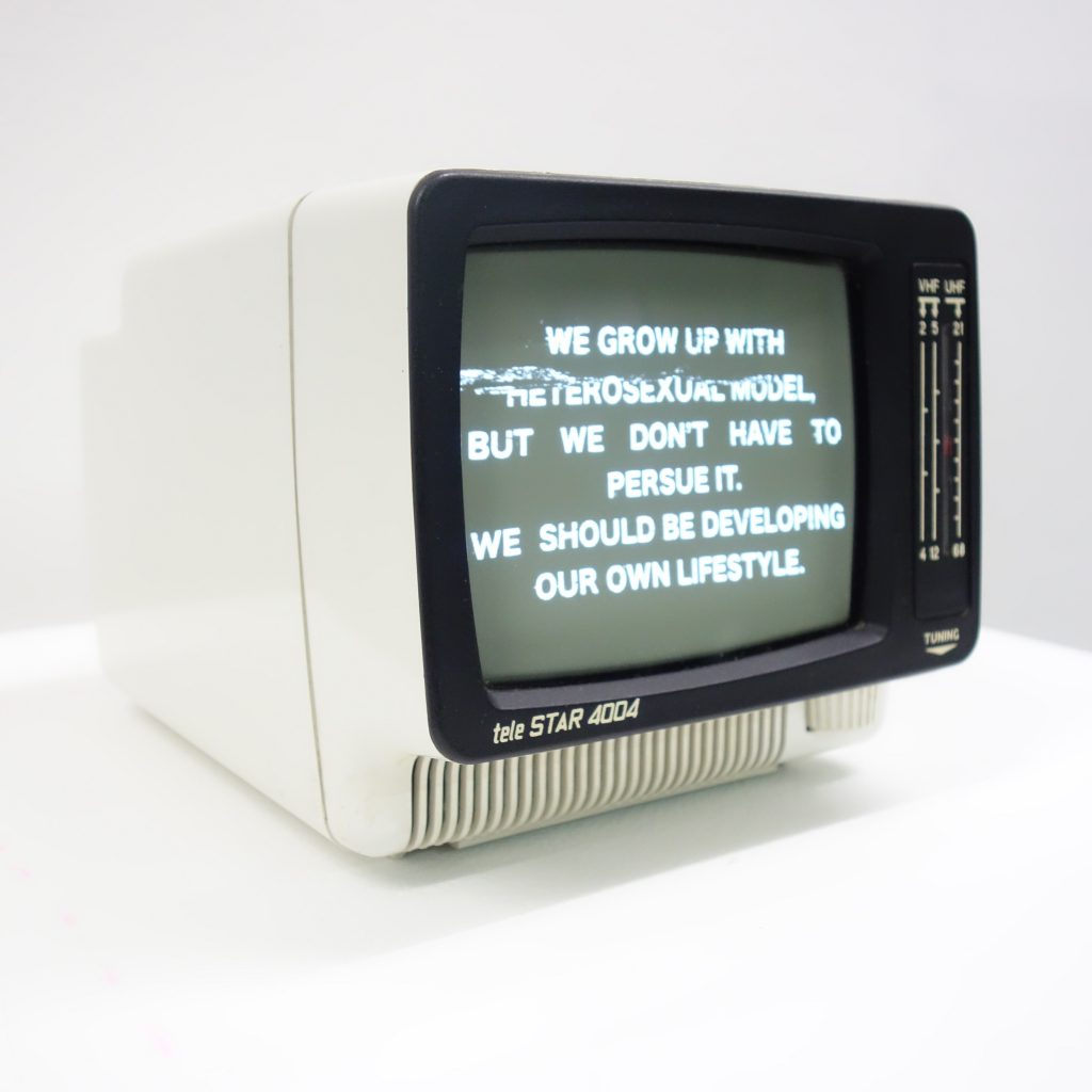 Artwork with black and white text on an old computer monitor by Nikita Zhukovskiy, new media art for the Stonewall 50th Anniversary Exhibition at GlogauAIR