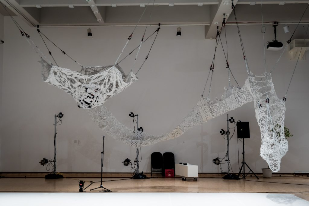 Photograph of an art installation with suspended string hammocks by artist Astrid Lloyd, resident at GlogauAIR 2019