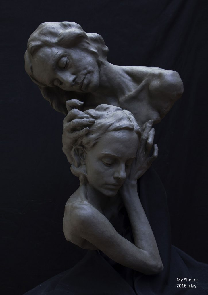 Photograph of a clay sculpture of a mother and daughter embracing, by artist Alexandra Slava, resident at GlogauAIR 2019