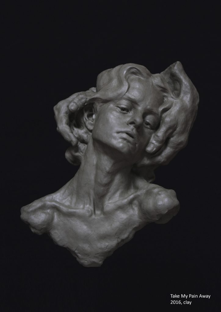 Photograph of clay sculpture showing a person who has their head in somebody else's hands, by artist Alexandra Slava, resident at GlogauAIR 2019