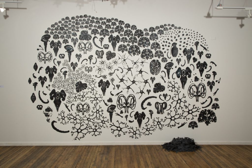Photograph of black illustrations on a white wall by artist Heloisa Pomfret, resident at GlogauAIR 2019