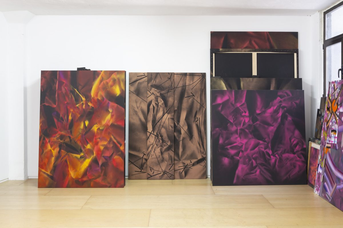 Photograph of three paintings against a wall by artist Ismael Iglesias, resident artist at GlogauAIR 2019