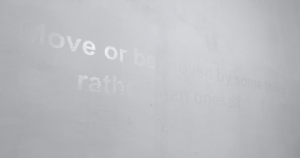 Photograph of partially hidden sentence on a white wall, by GlogauAIR resident Nestor Garcia