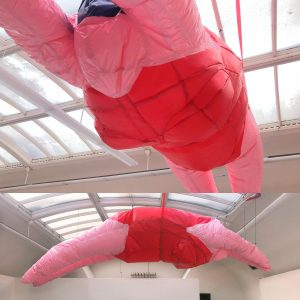 Large scale balloon installation of pink woman in red bikini by artist Dani Toral, resident at GlogauAIR 2019