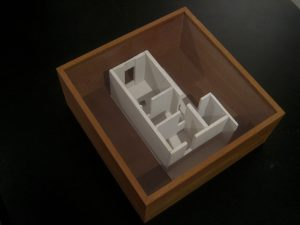Photograph of brown wooden box and a white 3D model inside. By artist Marcos Kaiser, resident artist at GlogauAIR January 2020