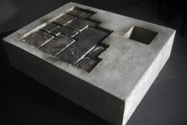 Photograph of concrete block with cut out section showing brickwork. By artist Marcos Kaiser, resident at GlogauAIR January 2020