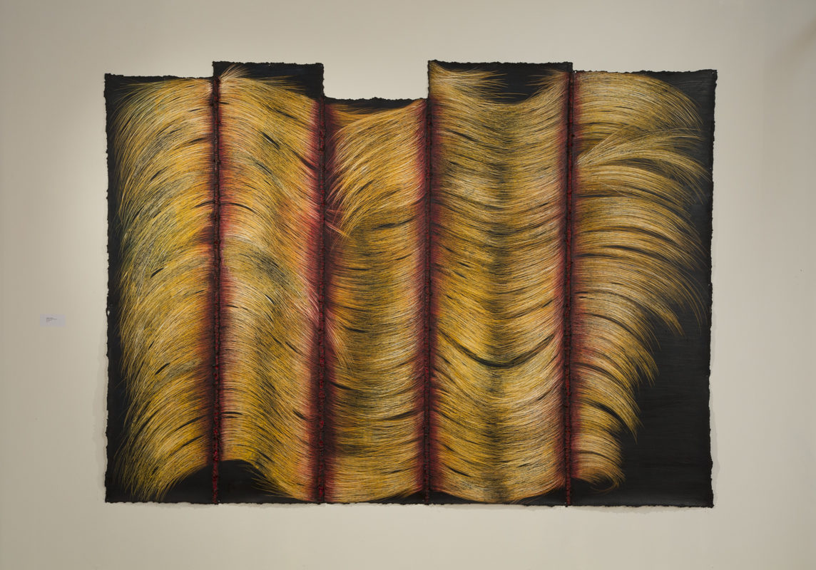 Photograph of abstract yellow, brown and red painting with vertical linear sections, by artist Heloisa Pomfret, resident at GlogauAIR 2019