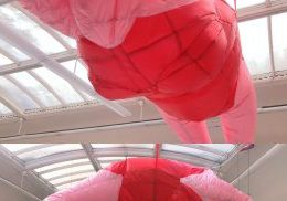 Large scale balloon installation of pink woman in swimsuit